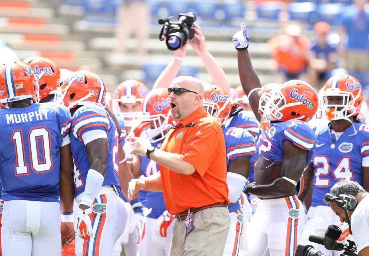 Gators strength and conditioning coach Jeff Dillman pumps up Florida's players before their home opener on Sept. 1 against Bowling Green. / Gator Country photo by Curtiss Bryant
