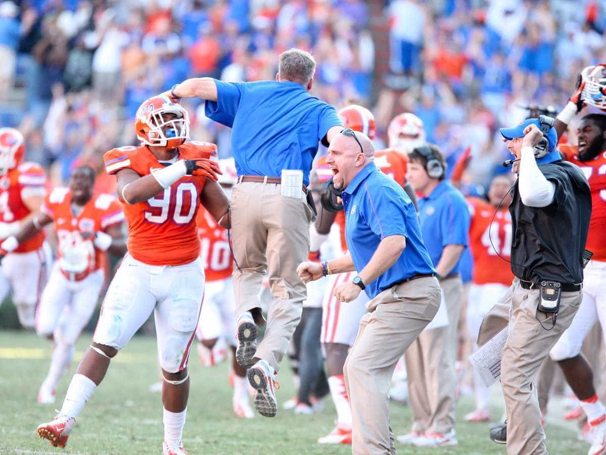 New Florida defensive coordinator DJ Durkin, leaping, shows his energetic side after a blocked punt resulted in a game-winning touchdown against Louisiana-Lafayette on Nov. 10, 2012.  / Gator Country photo by Curtiss Bryant