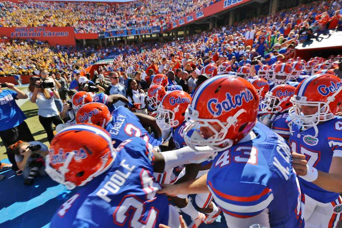 Florida Gators run out of the tunnel and onto Florida Field. / Gator Country photo by Curtiss Bryant