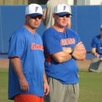 Florida baseball coach Kevin O'Sullivan watches his team's Friday practice along with volunteer assistant coach Don Norris. / Gator Country photo by Mike Capshaw