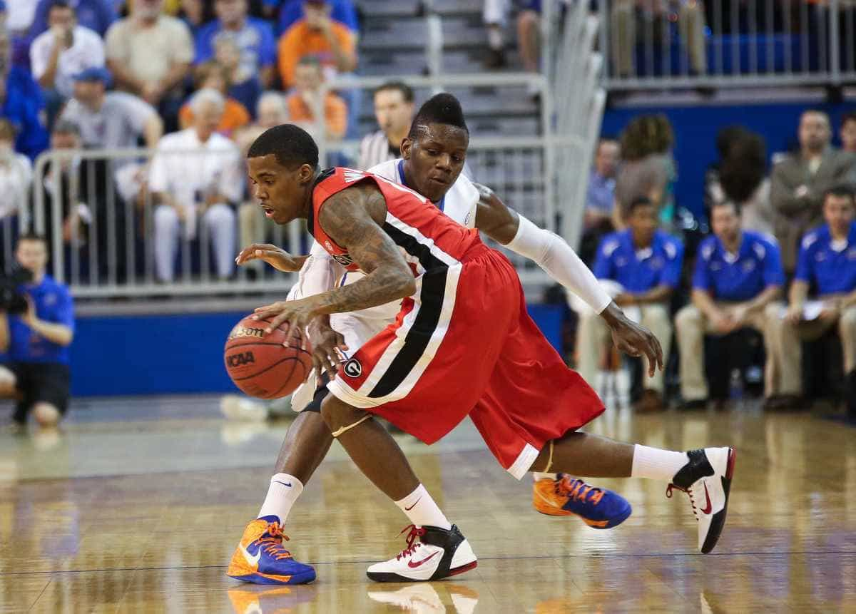 Florida forward Will Yeguete attempts to steal the ball from Georgia guard Vincent Williams during the Gators' 77-44 home win on Jan. 9. / Gator Country photo by Curtiss Bryant