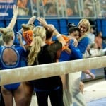 Florida senior Marissa King is greeted by her coach after performing on the balance beam during the Gators' 197.525, 196.825  win against the Georgia Bulldogs on Friday, February 24, 2012 at the Stephen C. O'Connell Center in Gainesville, Fla. / Gator Country photo by Saj Guevara