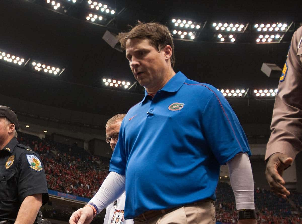 Florida coach Will Muschamp walks off the field after the Gators' 33-23 loss against Louisville on Jan. 2 in the Sugar Bowl. / Gator Country photo by Saj Guevara
