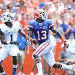 Florida Gators football receiver goes up for a catch against Kentucky.
