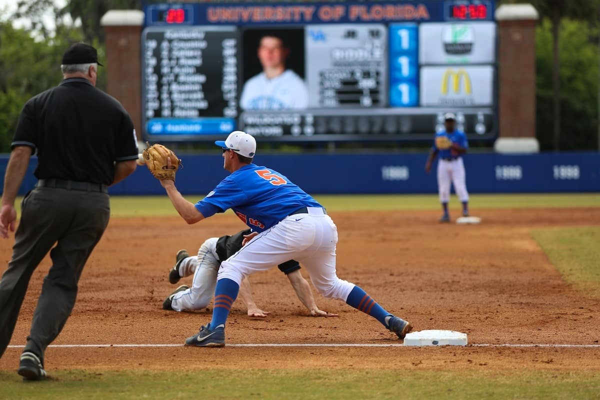 Florida Gator Zack Powers tags out a runner. \Photo by Wes Hall.