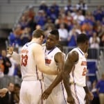 Florida Gators' forward Will Yeguete embraces teammate Erik Murphy in Yeguete's second game back since knee surgery. Gator Country photo by Curtiss Bryant.