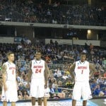 Scottie Wilbekin, Casey Prather and Kenny Boynton look on as their team beats FGCU in the Sweet Sixteen.