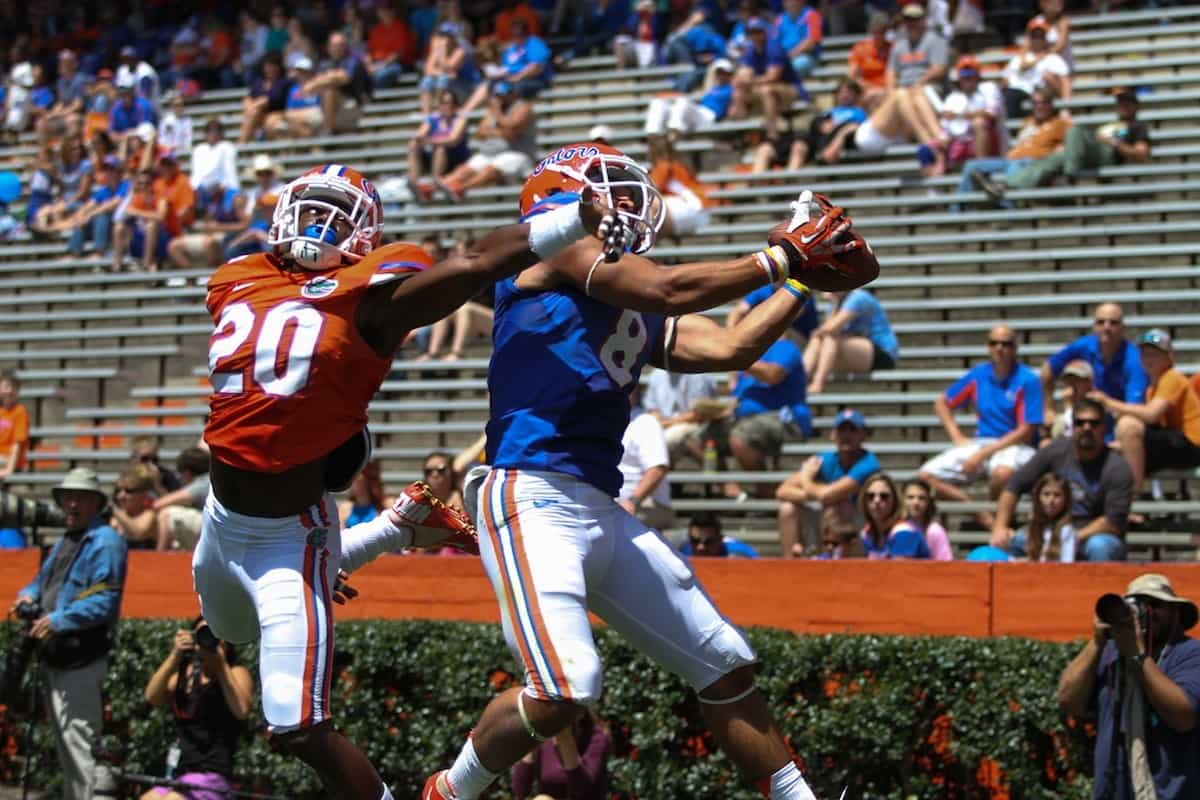 Trey Burton makes a highlight reel catch over Marcus Maye in the spring game Saturday. \Gator Country photo by Wes Hall.