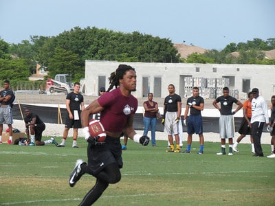 Ermon Lane turns upfield after a reception at the IMG 7-on-7 in Bradenton last summer.