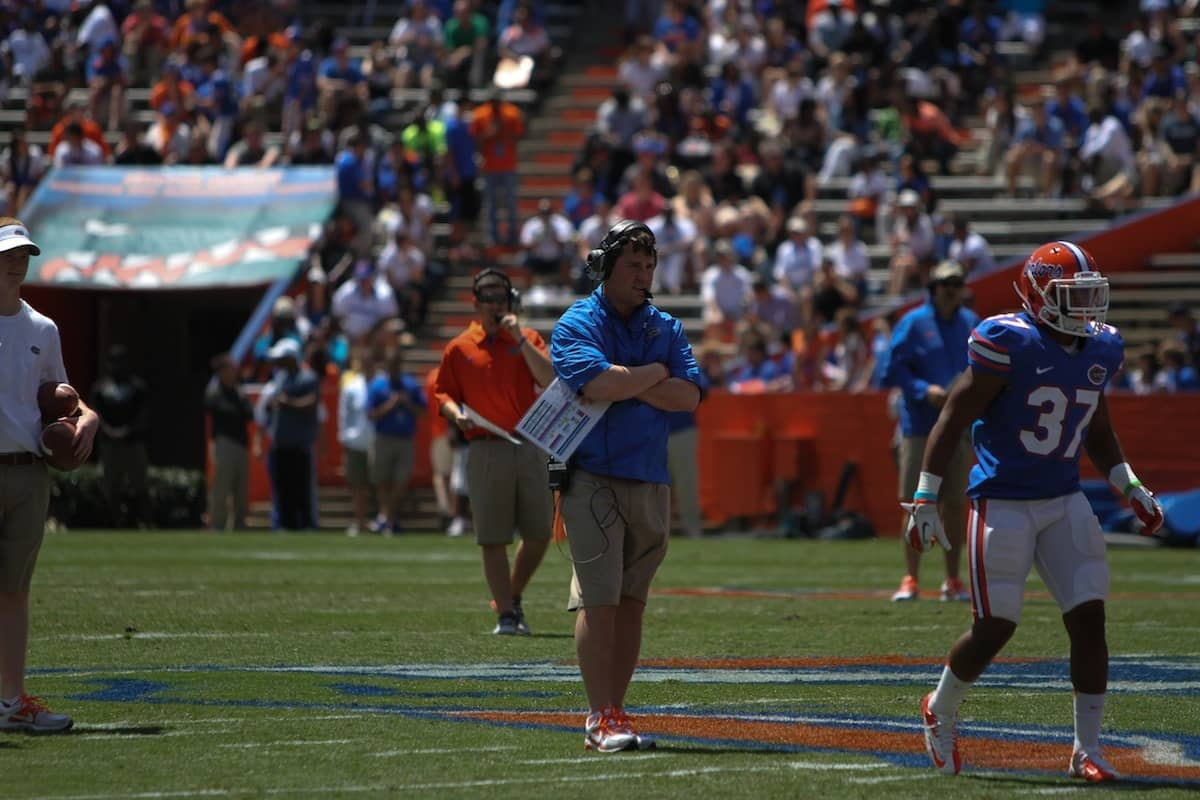 Will Muschamp stands on the field during the 2013 Orange and Blue Debut. \Gator Country photo by Wes Hall.