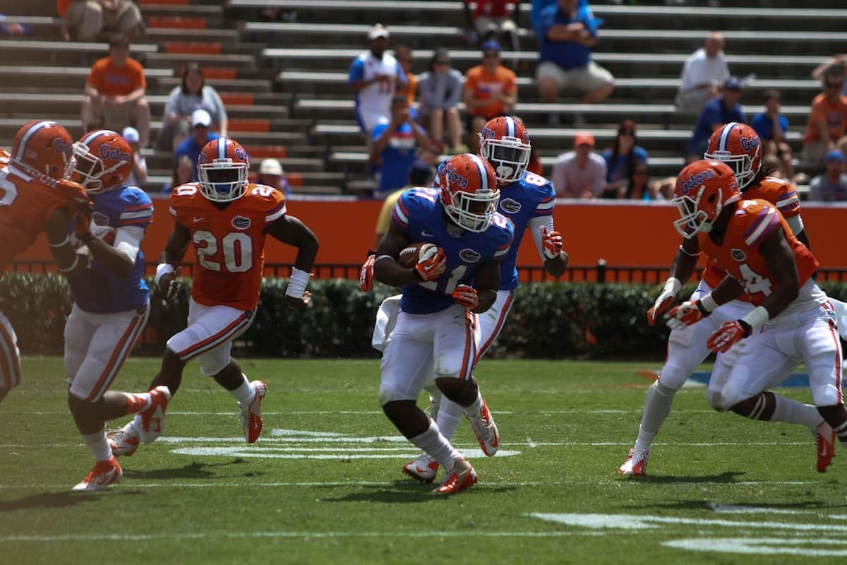 Kelvin Taylor carries the ball during the Orange and Blue Debut Saturday in the Swamp. \Gator Country photo by Wes Hall.