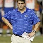 Florida head coach Will Muschamp looks on during Friday Night Lights, a one-night football camp hosted by the Florida Gators, on Friday, July 22, 2011 at Ben Hill Griffin Stadium in Gainesville, Fla. / Gator Country photo by Tim Casey