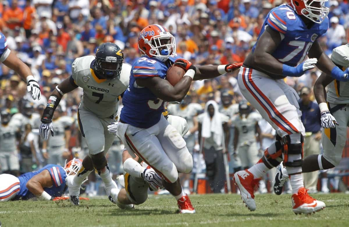 Florida Gators running back Mack Brown (33) runs the ball in for a touchdown during the first half against the Toledo Rockets at Ben Hill Griffin Stadium. Photo Credit: Kim Klement-USA TODAY Sports