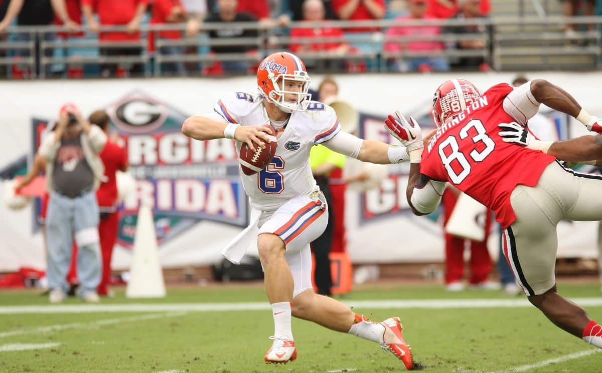 Florida Gators quarterback Jeff Driskel evades a Georgia defender.