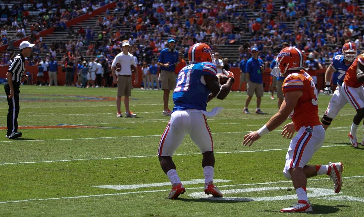 Freshmen running back Kelvin Taylor receives a pass during the Orange and Blue Debut.