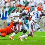 Florida Gators RB Mack Brown runs and is tackled. Gator Country photo by David Bowie.