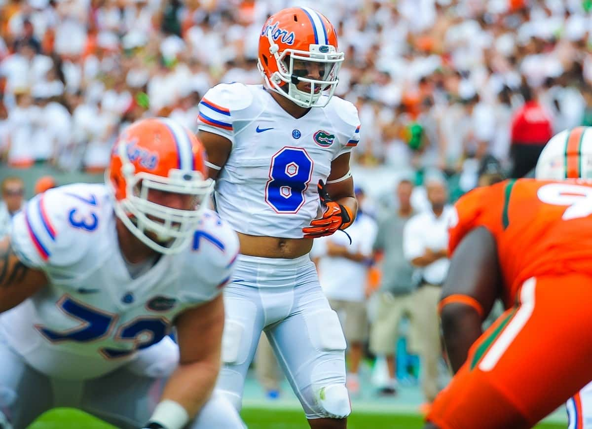Florida Gators WR Trey Burton in the wildcat prepares to hike the ball. Picture by David Bowie.