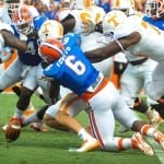Florida Gators DE Dante Fowler tackles the Tennessee RB and causes a fumble. Gator Country Photo by David Bowie.