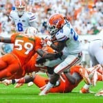 Florida Gators RB Matt Jones gets tripped up by a Hurricane defender at Sun Life Stadium. Photo by David Bowie.