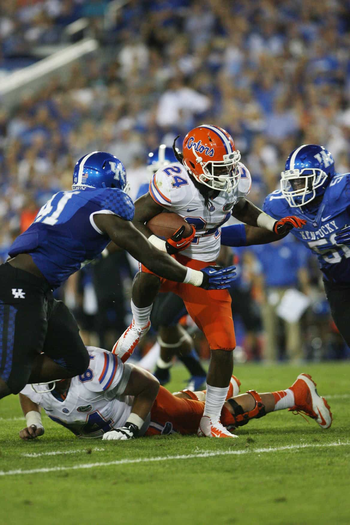 Sep 28, 2013; Lexington, KY, USA; Florida Gators running back Matt Jones (24) runs the ball against Kentucky Wildcats defensive lineman TraVaughn Paschal (41) and defensive lineman Tristian Johnson (51) at Commonwealth Stadium. Photo: Mark Zerof-USA TODAY Sports