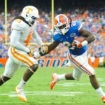 Florida Gators RB Matt Jones tries to evade the Tennessee defender as he runs in for the touchdown.  Florida Gators vs. Tennessee Volunteers. Photo courtesy of David Bowie.