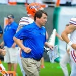 Coach Muschamp and the Florida Gators on the the field for the Miami game. Photo by David Bowie.
