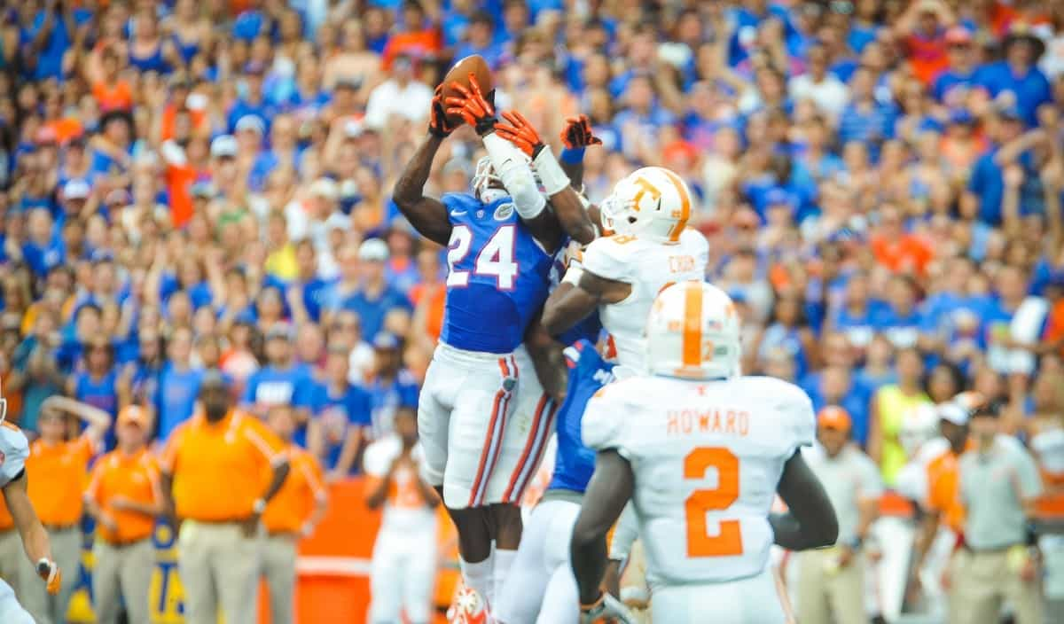 Florida Gators DB Brian Poole leaps into the air to intercept the ball. Photo courtesy of David Bowie.
