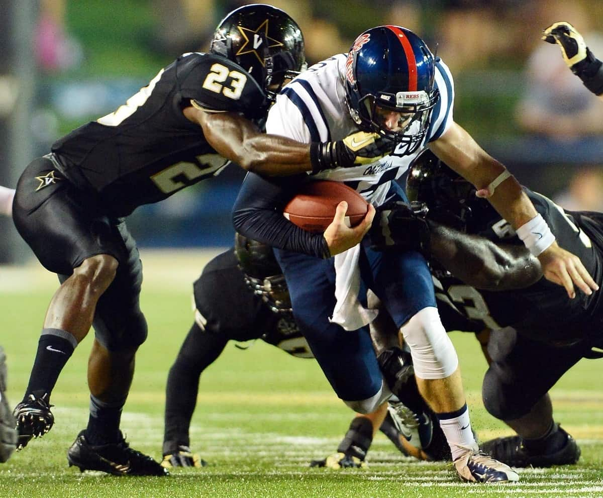 Mississippi Rebels quarterback Bo Wallace (14) is tackled by Vanderbilt Commodores cornerback Andre Hal (23) during the first half at Vanderbilt Stadium. The Rebels beat the Commodores 39-35. Photo Credit: Don McPeak-USA TODAY Sports.