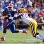 Oct 12, 2013; Baton Rouge, LA, USA; Florida Gators running back Mack Brown (33) breaks a tackle of LSU Tigers linebacker Kwon Alexander (25) during the first quarter of their game at Tiger Stadium. Photo: Chuck Cook-USA TODAY Sports
