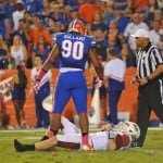 Defensive Lineman Jonathan Bullard stands over Arksansas QB Brandon Allen after knocking him to the turf. Florida Gators vs. Arkansas Razorbacks. October 5th, 2013. Photo: David Bowie