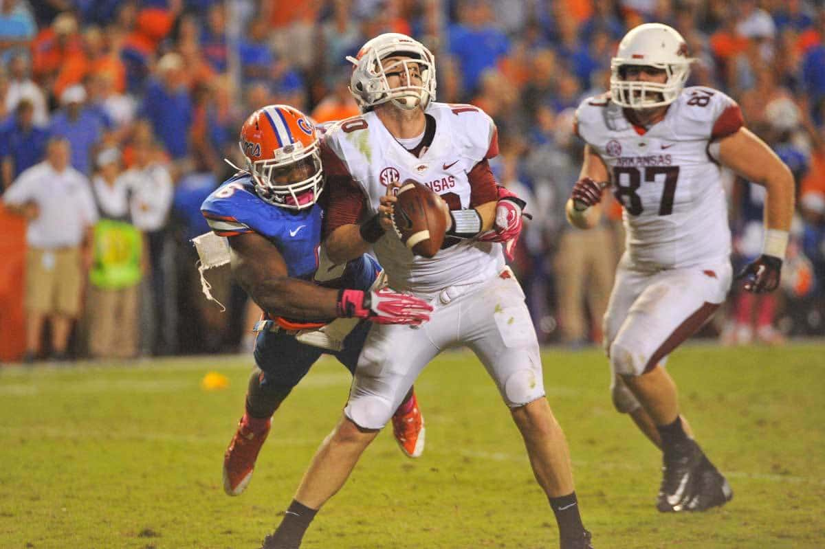 Dante Fowler hits Arkansas QB Brandon Allen from behind in Florida's 2013 win over Arkansas / Gator Country Photo by David Bowie