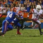 Oct 5, 2013; Gainesville, FL, USA; Arkansas Razorbacks running back Alex Collins (3) is chased by Florida Gators defensive end Dante Fowler Jr. (6) during the first half of the game at Ben Hill Griffin Stadium. Photo: Rob Foldy-USA TODAY Sports