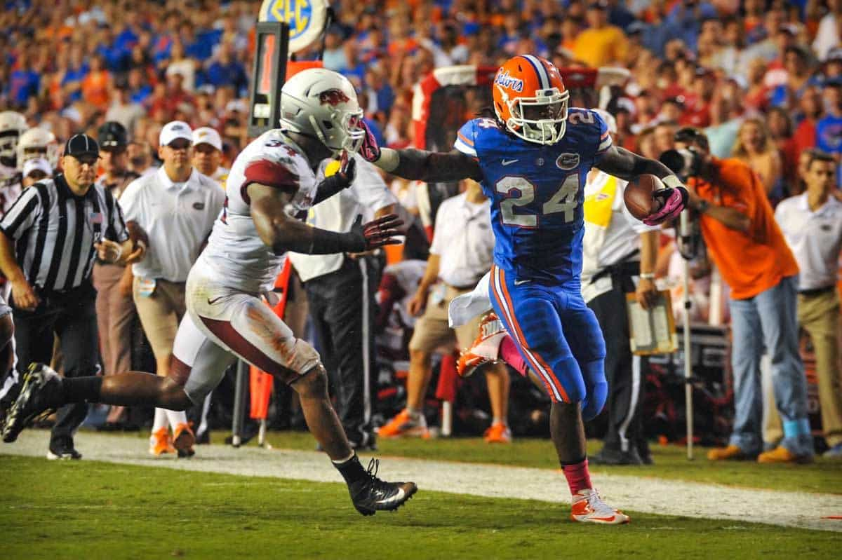 lorida Gator running back Matt Jones (24) stiff arms his way a touchdown against Arkansas. Gator Counry Photo by David Bowie