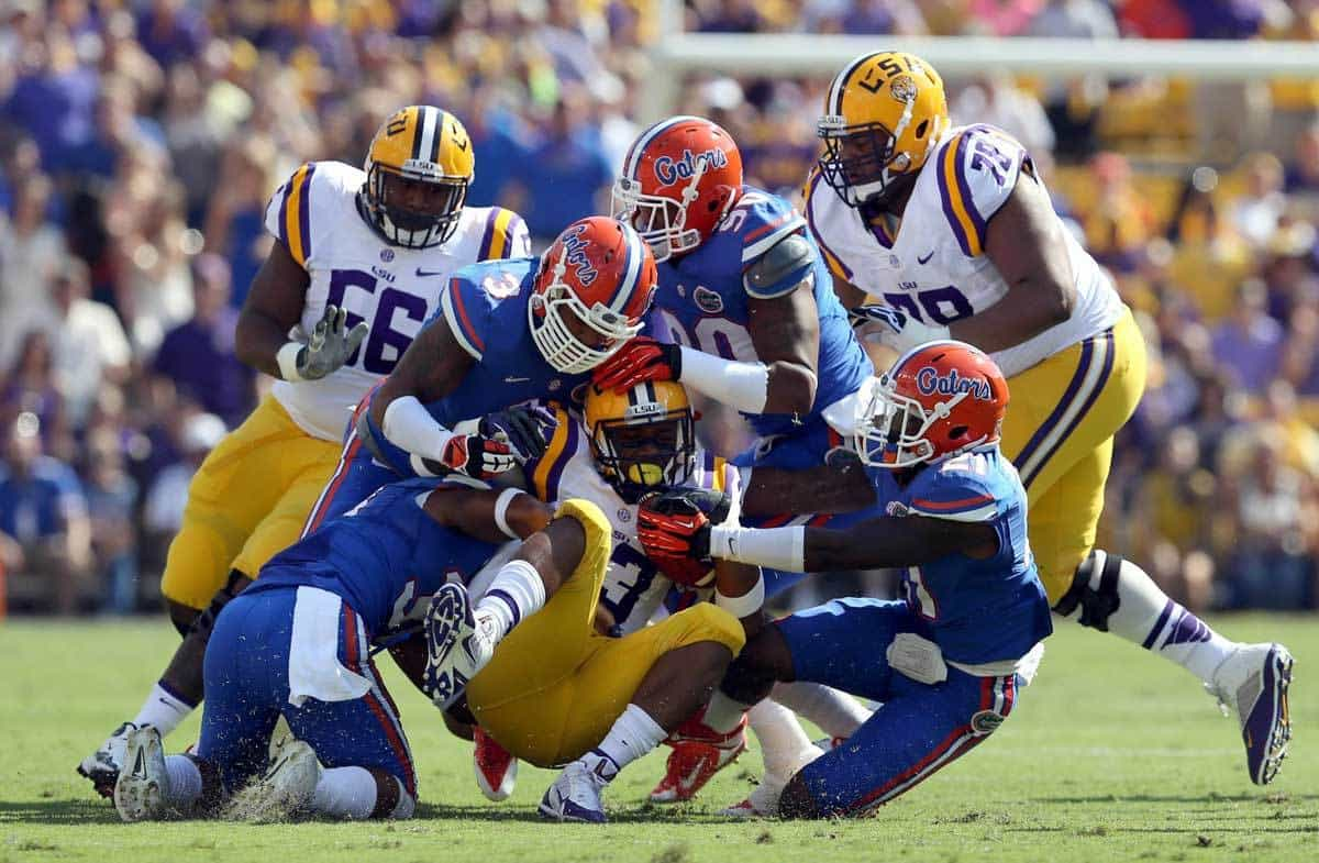 Oct 12, 2013; Baton Rouge, LA, USA; LSU Tigers running back Jeremy Hill (33) is tackled by a multiple Florida Gators defenders during the first quarter of their game at Tiger Stadium. Photo: Chuck Cook-USA TODAY Sports