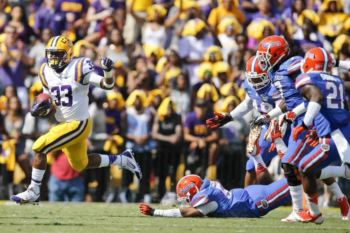 Oct 12, 2013; Baton Rouge, LA, USA; LSU Tigers running back Jeremy Hill (33) runs against the Florida Gators during the first quarter of a game at Tiger Stadium. Photo: Derick E. Hingle-USA TODAY Sports