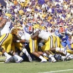LSU quarterback Anthony Jenkins sneaks into the end zone behind his offensive line.