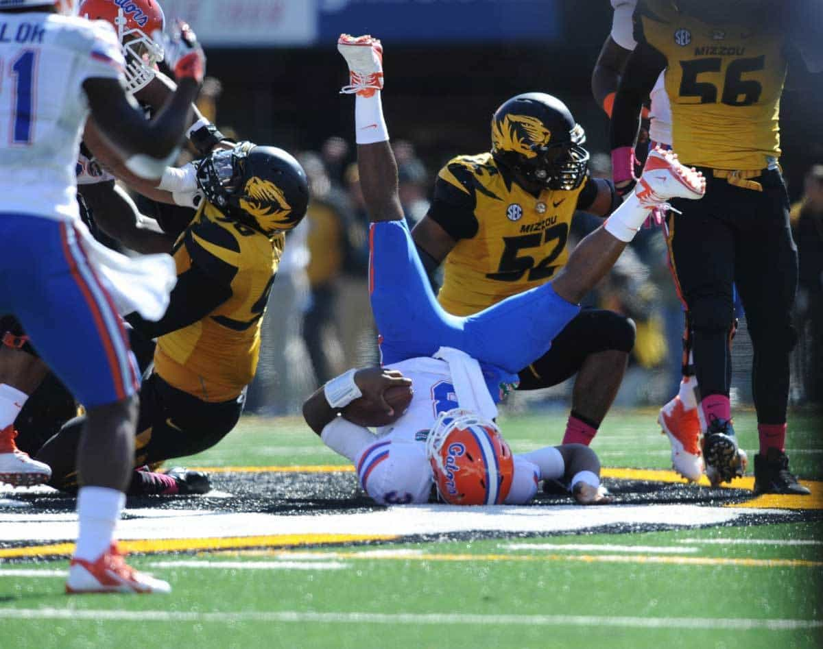 Oct 19, 2013; Columbia, MO, USA; Florida Gators quarterback Tyler Murphy (3) is sacked by Missouri Tigers defensive lineman Michael Sam (52) during the second half at Faurot Field. Missouri won 36-17. Photo: Denny Medley-USA TODAY Sports