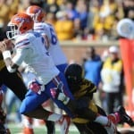 Oct 19, 2013; Columbia, MO, USA; Florida Gators quarterback Tyler Murphy (3) is sacked by Missouri Tigers defensive lineman Michael Sam (52) during the first half at Faurot Field. Photo: Denny Medley-USA TODAY Sports