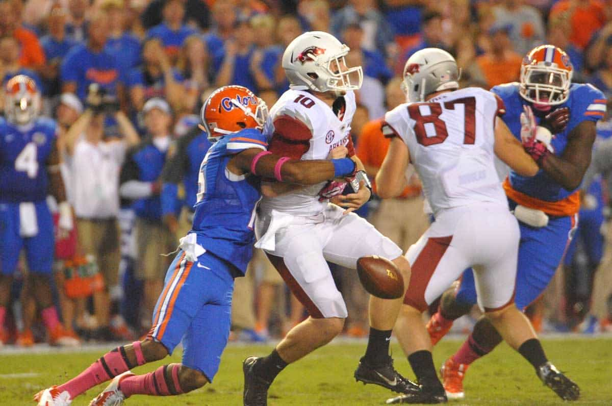 Gator DB Loucheiz Purifoy sacks Arkansas QB Brandon Allen, knocking the ball loose for the first turnover of the half for Arkansas. Florida Gators vs Arkansas Razorbacks. October 5th, 2013. Photo: David Bowie.
