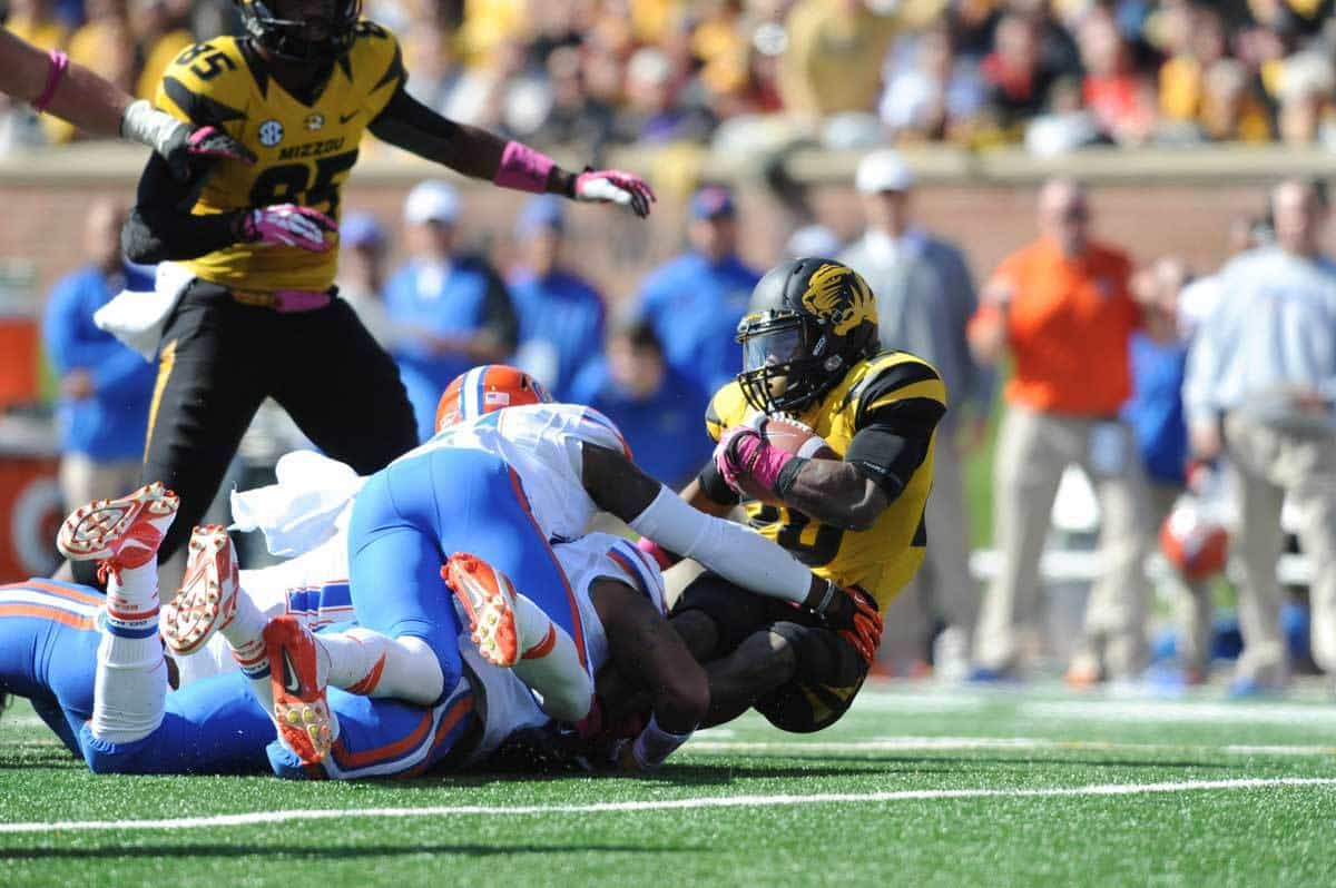 Oct 19, 2013; Columbia, MO, USA; Missouri Tigers running back Henry Josey (20) is tackled by Florida Gators defensive back Loucheiz Purifoy (15) during the first half at Faurot Field. Photo: Denny Medley-USA TODAY Sports