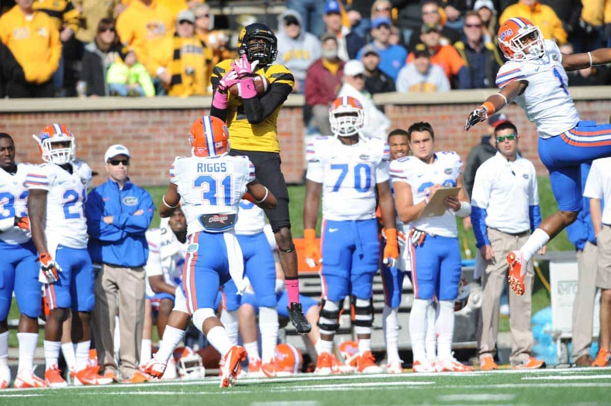 Oct 19, 2013; Columbia, MO, USA; Missouri Tigers wide receiver L'Damian Washington (2) catches a pass as Florida Gators defensive back Cody Riggs (31) defends during the first half at Faurot Field. Photo: Denny Medley-USA TODAY Sports