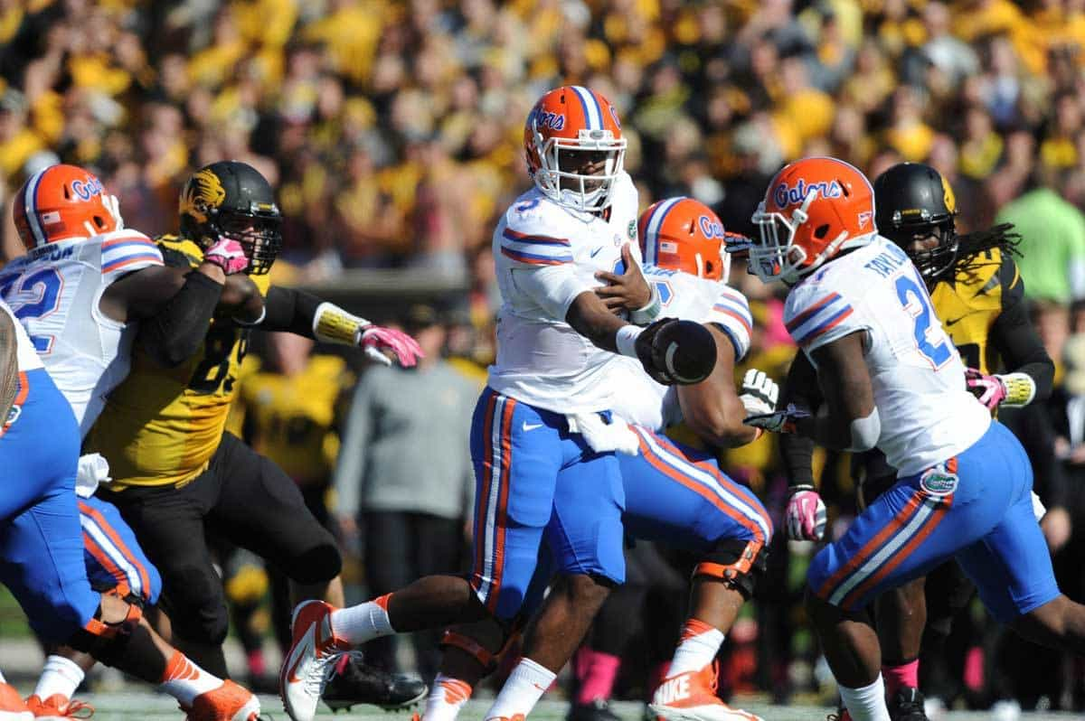 Oct 19, 2013; Columbia, MO, USA; Florida Gators quarterback Tyler Murphy (3) hands off to running back Kelvin Taylor (21) during the second half of the game against the Missouri Tigers at Faurot Field. Missouri won 36-17. Photo: Denny Medley-USA TODAY Sports