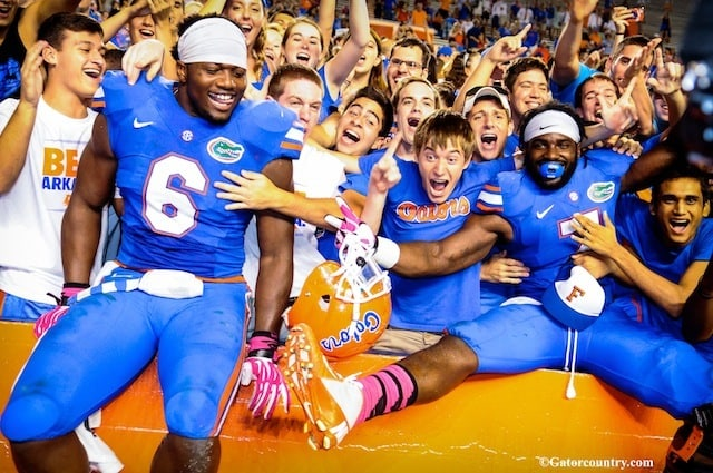 Florida Gators Dante Fowler (6) and Ronald Powell (7) jump into the stands to celebrate with the fans.  Florida vs Arkansas; Gainesville, FL; Oct 5th, 2013.