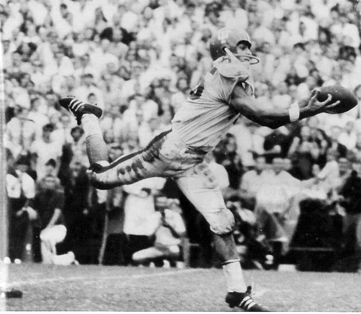 Carlos Alvarez stretches to catch a touchdown pass against Miami at the Orange Bowl in 1969.
