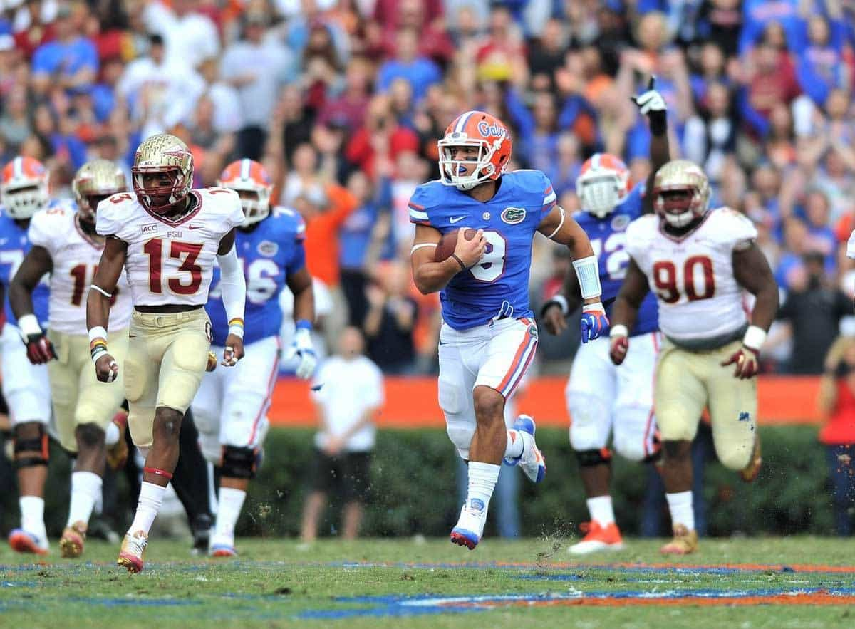 Nov 30, 2013; Gainesville, FL, USA; Florida Gators wide receiver Trey Burton (8) runs past Florida State Seminoles defense during the first quarter at Ben Hill Griffin Stadium. Photo: Steve Mitchell-USA TODAY Sports