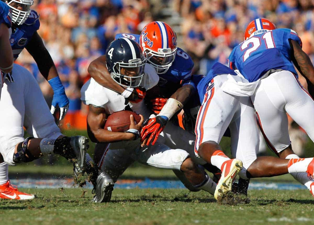 Nov 23, 2013; Gainesville, FL, USA; Florida Gators defensive end Dante Fowler Jr. (6) tackles Georgia Southern Eagles quarterback Kevin Ellison (4) during the second quarter at Ben Hill Griffin Stadium. Photo: Kim Klement-USA TODAY Sports