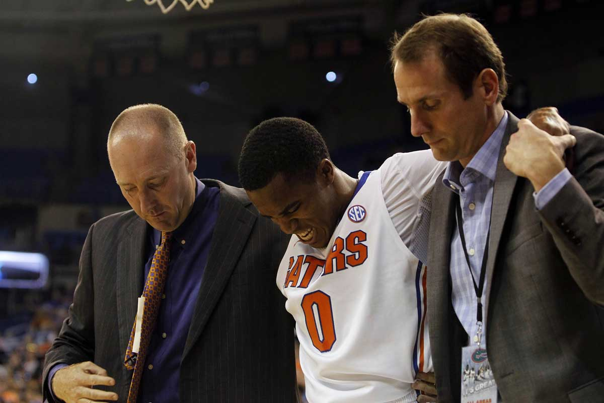 Nov 18, 2013; Gainesville, FL, USA; Florida Gators guard Kasey Hill (0) gets taken off the court after he hurt his ankle during the second half against the Southern Jaguars at Stephen C. O'Connell Center. Florida Gators defeated the Southern Jaguars 67-53. Photo: Kim Klement-USA TODAY Sports