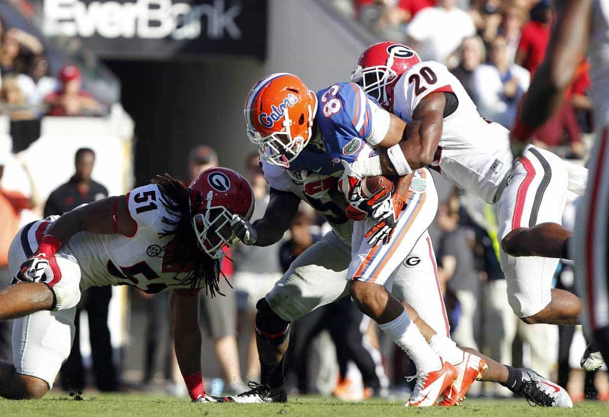 Nov 2, 2013; Jacksonville, FL, USA; Florida Gators wide receiver Solomon Patton (83) runs with the ball as Georgia Bulldogs defensive back Quincy Mauger (20) and linebacker Ramik Wilson (51) tackle during the second quarter at EverBank Field. Photo: Kim Klement-USA TODAY Sports