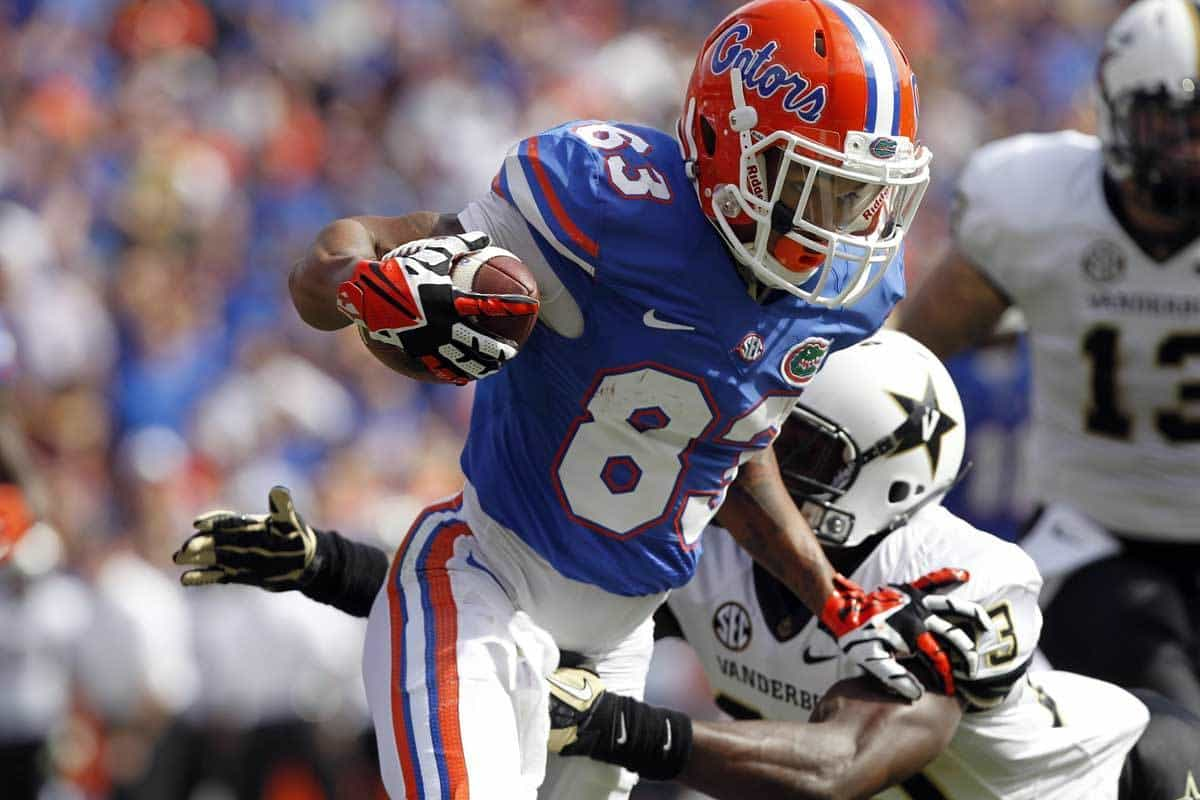 Nov 9, 2013; Gainesville, FL, USA; Florida Gators wide receiver Solomon Patton (83) runs with the ball as Vanderbilt Commodores defensive back Andre Hal (23) defends during the second quarter at Ben Hill Griffin Stadium. Photo: Kim Klement-USA TODAY Sports