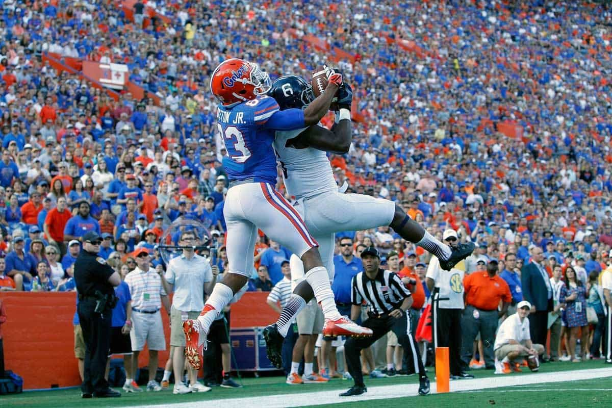Nov 23, 2013; Gainesville, FL, USA;Georgia Southern Eagles safety Darius Safford (6) attempts to intercept the ball as Florida Gators wide receiver Solomon Patton (83) breaks it up during the first quarter at Ben Hill Griffin Stadium. Photo: Kim Klement-USA TODAY Sports